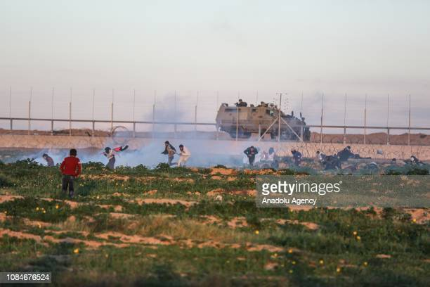 Palestinian demonstrators are seen after Israeli forces' intervention with tear gas canisters during a protest within 'Great March of Return'...