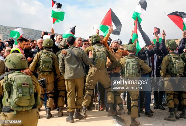 Palestinian demonstrators are surrounded by Israeli soldiers during a demonstration near the West Bank village of Tubas, near the Jordan Valley, on...