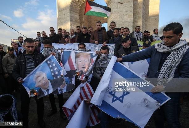 Palestinian demonstrators burn images of US President Donald Trump as they protest against a US brokered Middle East peace plan, in Rafah in the...