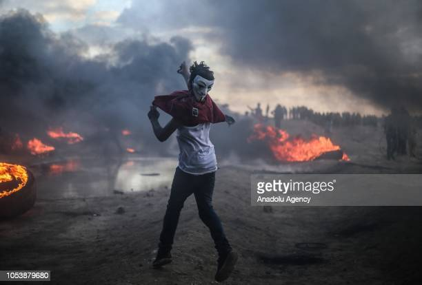 "Palestinian demonstrators burn tyres after the intervention of Israeli forces during the ""Great March of Return"" demonstration on the Israel-Gaza..."