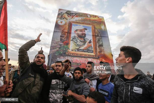 Palestinian demonstrators carry a photo of the martyr Baha Abu AlAtta during the demonstration Palestinians clashes with Israeli security forces...