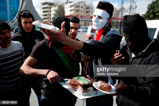 TOPSHOT Palestinian demonstrators celebrate the birthday of a fellow protester during clashes following a demonstration in the West Bank city of...