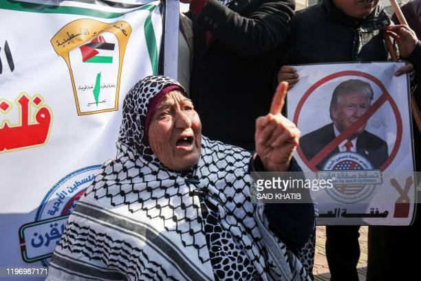 Palestinian demonstrators chant slogans against US President Donald Trump during a protest against his expected announcement of a peace plan, in...