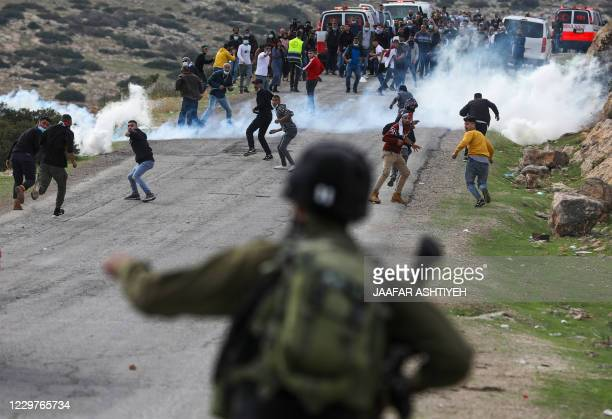 TOPSHOT Palestinian demonstrators clash with Israeli soldiers during a protest against Jewish settlements on November 24 in the Jordan Valley in the...