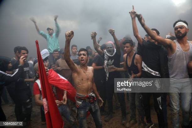 Palestinian demonstrators during a protest calling for lifting the blockade on Gaza at the IsraelGaza border fence in Gaza October 26 2018