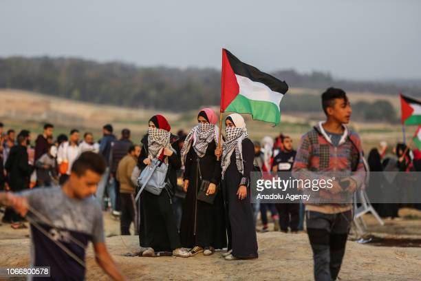 "Palestinian demonstrators gather during a ""Great March of Return"" demonstration near Al Bureij Refugee Camp on the Gaza-Israel border, in Gaza City,..."