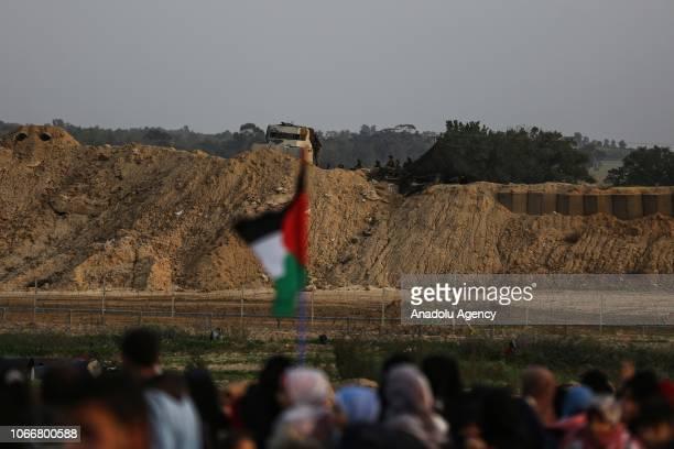 Palestinian demonstrators gather during a Great March of Return demonstration near Al Bureij Refugee Camp on the GazaIsrael border in Gaza City Gaza...