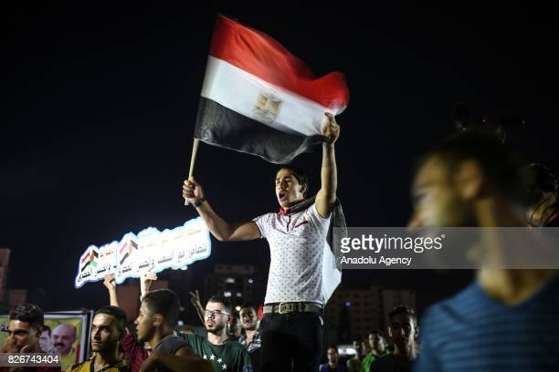 Palestinian demonstrators hold Egyptian flags to show their solidarity with Egyptian people during a protest against terror attacks in Egypt in front...