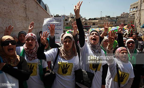 Palestinian demonstrators shout slogans during a protest in support of the Muslim Brotherhood in Egypt, after Friday prayers in the West Bank city of...