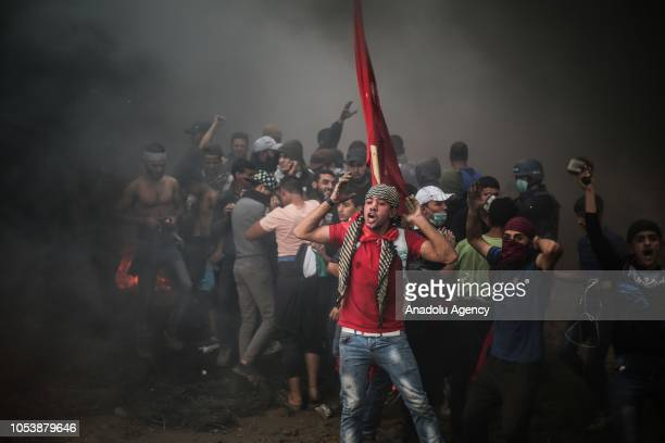 "Palestinian demonstrators shout slogans during the ""Great March of Return"" demonstration on the Israel-Gaza border near Malka in Gaza City, Gaza on..."