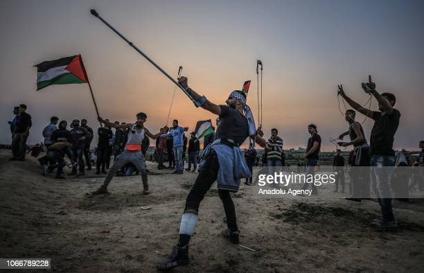 Palestinian demonstrators take part in a Great March of Return demonstration on the IsraelGaza border near Malka in Gaza City Gaza on November 30 2018