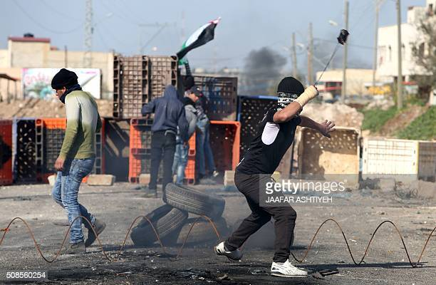 Palestinian demonstrators throw stones towards Israeli security forces during clashes in the Palestinian town of Qabatiya near Jenin in the north of...