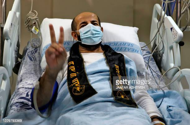 Palestinian detainee Maher alAkhras arrives at alNajah Hospital in the West Bank city of Nablus following his release by Israeli authorities on...