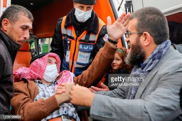 Palestinian detainee Maher alAkhras arrives at his home in the West Bank village of Seylat alDhahr south of Jenin city following his release by...