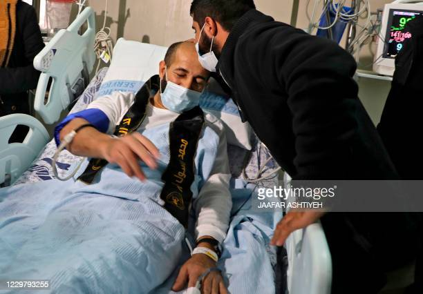 Palestinian detainee Maher alAkhras arrives to alNajah Hospital in the West Bank city of Nablus following his release by Israeli authorities on...