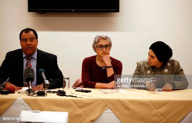 CORRECTION Palestinian doctor Izzeldin Abuelaish and two of his daughters Shada and Rafa give a press conference on March 14 2017 in East Jerusalem...