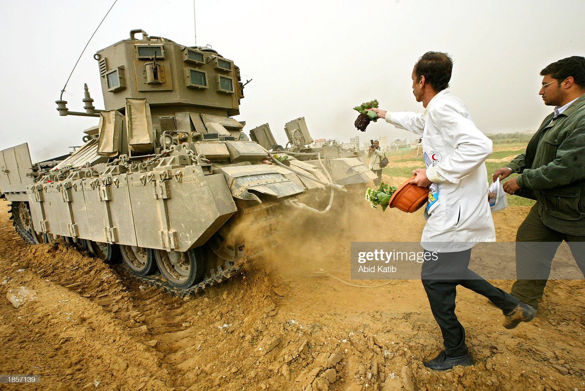 https://media.gettyimages.com/photos/palestinian-doctor-samer-nassr-allah-tosses-flowers-at-an-israel-tank-picture-id1857139?s=2048x2048