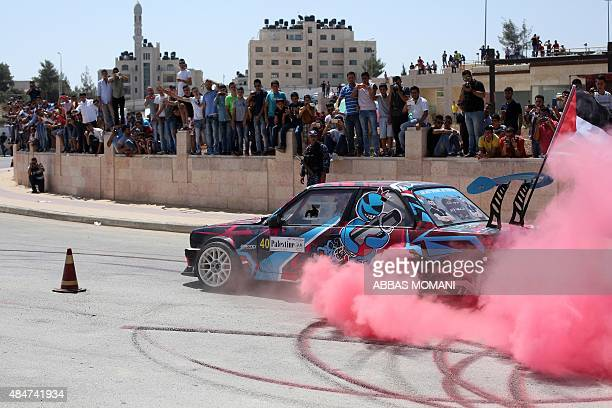 A Palestinian driver competes in a local car race organised by the Palestinian Motor Sport and Motorcycle Federation on August 21 2015 in the West...