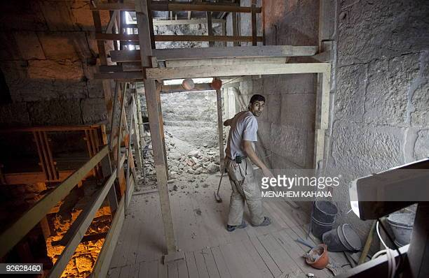 A Palestinian employee of the Israeli Antiquity Authority works at the site of excavations in the Western Wall tunnels on October 22 2009 in...