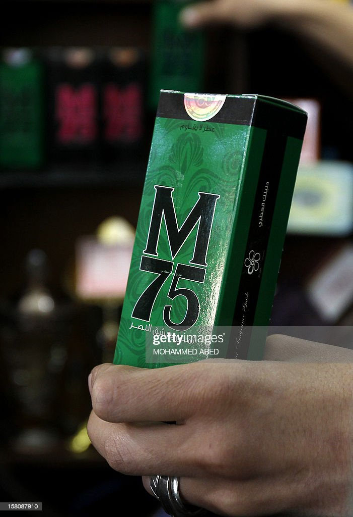 A Palestinian employee of the 'Stay Stylish' shop holds a packaged M75 perfume bottle in Gaza City on December 10, 2012. 'Victory' has never smelled so sweet -- or at least that's what they would have you believe at the shop selling Gaza's newest fragrance named M75 after a long-range Hamas rocket.