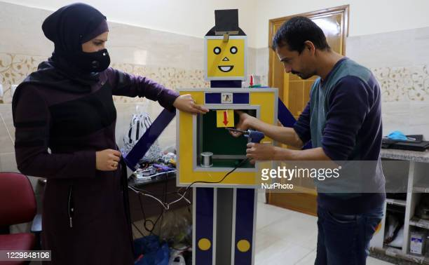 Palestinian entrepreneur Heba al-Hindi demonstrates a locally-designed and manufactured smart sterilisation device in Gaza City on November 16 as the...