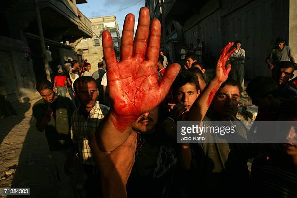 Palestinian face off with an Israeli tank during clashes July 6 2006 in Beit Lahia northern Gaza Strip Israeli infantry and armor launched a...