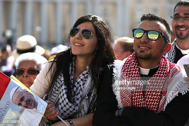Palestinian faithful attend a canonisation ceremony held by Pope Francis in St Peter's Square on May 17 2015 in Vatican City Vatican Pope Francis...
