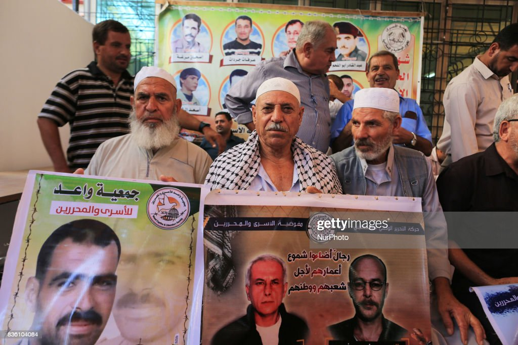 Palestinian families hold posters of their relatives as they gather for a demonstration to show their support for the Palestinian prisoners in Israeli jails, in front of International Committee of the Red Cross office in Gaza City, Gaza on August 21, 2017.