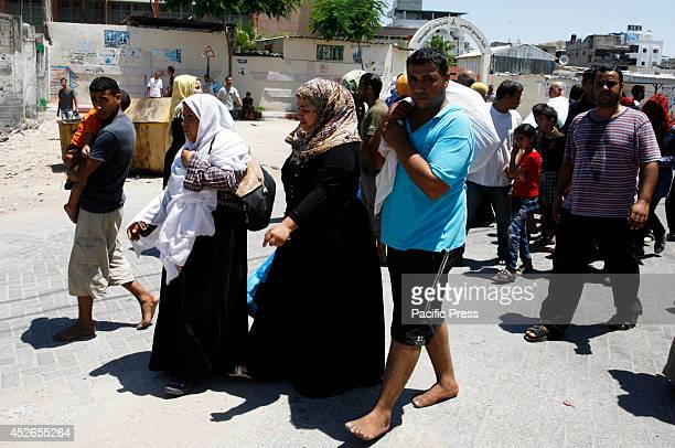 Palestinian families leave their homes to a safer location as the Israeli army continues to shell the area of Khan Yunis, in the Southern Gaza Strip....
