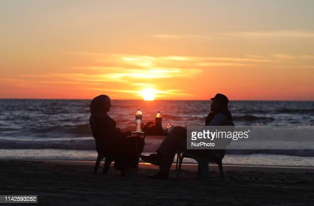 A Palestinian family break their their fast at the beach during the holy month of Ramadan in Gaza City 10May 2019