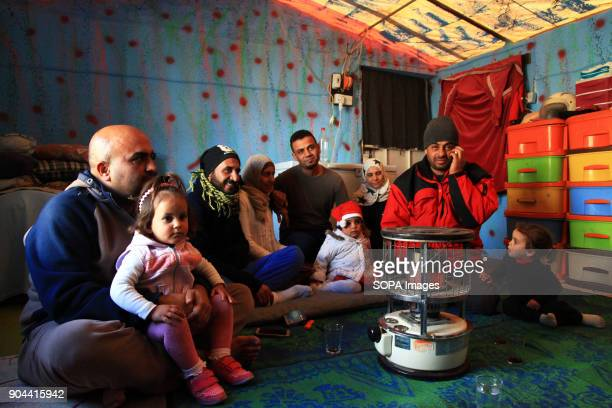 Palestinian family inside their home in a refugee camp on the outskirts of Erbil Palestinian families living in a refugee camp outside of Erbil Iraq...