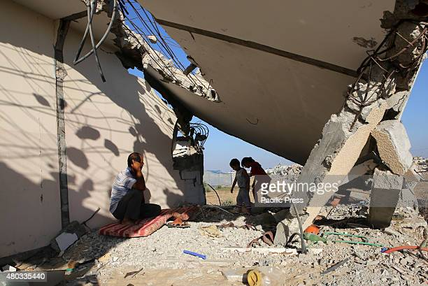 Palestinian family inspecting their house which was destroyed during the 50day Israeli war against Gaza in the summer of 2014 in the village of...