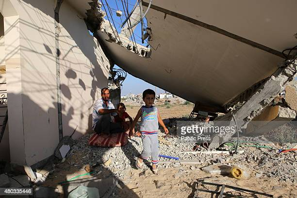 Palestinian family inspecting their house which was destroyed during the 50-day Israeli war against Gaza in the summer of 2014, in the village of...
