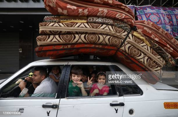 Palestinian family returns to their house in Gaza City on May 21 after a ceasefire has been agreed between Israel and Hamas. - A ceasefire between...