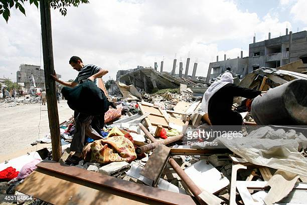 Palestinian family searching the wreckage of a building, which was hit in an Israeli strike, in Rafah, in the southern Gaza Strip. Israel said it...