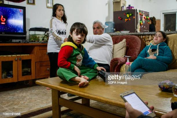Palestinian family seen at their home in Dheisheh Refugee Camp