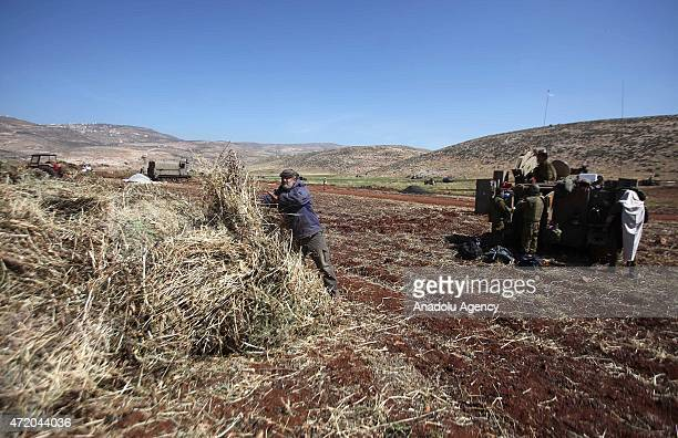 Palestinian farmer continues to work while the Israel's army carry out a military exercise in Aqraba village located in Nablus northen West Bank on...
