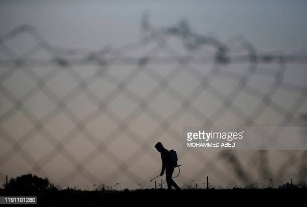 A Palestinian farmer sprays his farm with pesticides in Beit Lahia in the northern Gaza Strip on December 31 2019