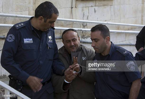 Palestinian Fatah leader Marwan Barghuti is escorted by Israeli police into the Magistrate's Court for a hearing in Jerusalem on January 25 2012...