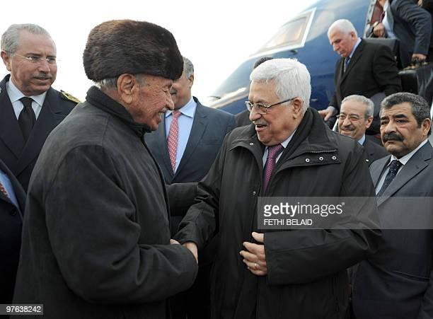 Palestinian Fatah member Ahmed Afana Abou Mootasim greets Palestinian President Mahmud Abbas upon his arrival at Tunis Carthage International airport...
