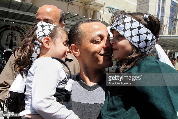 Palestinian Fatah member kisses his daughter after his release from a Hamasrun prison following the reconciliation talks between Hamas and Fatah on...