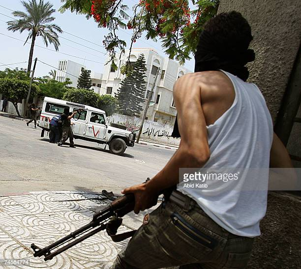 Palestinian Fatah militants clash with militants of the Hamas movement on June 13 2007 in Gaza City Gaza Strip In continued attempts at seizing...