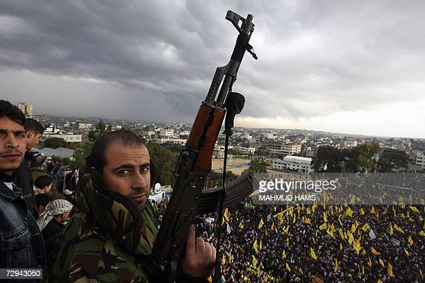 Palestinian Fatah militants loyal to their president Mahmud Abbas participate in a rally in Gaza City to celebrate 42 years since the party's...