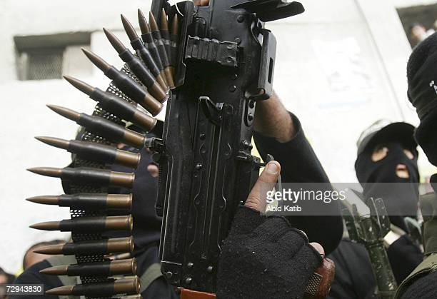 Palestinian Fatah supporters carry their guns during a rally to mark the 42nd anniversary of the political party on January 7 2007 in Gaza City Gaza...