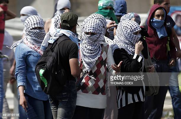 Palestinian female demonstraters prepare to throw stones ahead of clashes with Israeli security forces in Beit El near the West Bank city of Ramallah...