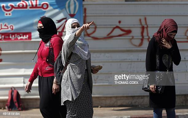 Palestinian female demonstraters take part in stone throwing during clashes with Israeli security forces in Beit El near the West Bank city of...