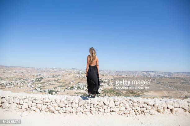 palestinian fields from the top of herodium, young woman in foreground - maxi dress stock pictures, royalty-free photos & images