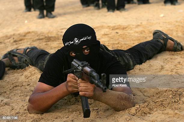 Palestinian fighters of the Hamasaffiliated Popular Resistance Committees participate during a military graduation ceremony on August 20 2008 at Beit...
