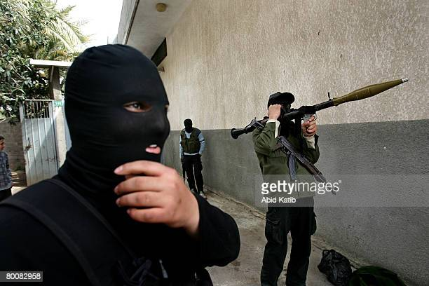 Palestinian fighters take up their position during an Israeli operation on March 02, 2008 east of Jabalia refugee camp northern Gaza Strip....