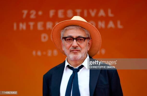 Palestinian film director and actor Elia Suleiman poses as he arrives for the screening of the film It Must Be Heaven at the 72nd edition of the...